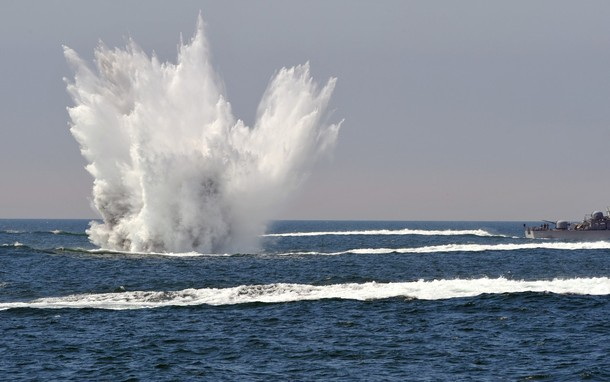 TOPSHOTS A South Korean patrol boat drops a depth charge during a drill off the western coast town of Taean on May 27, 2010. South Korea's navy staged a major anti-submarine exercise, its first show of strength since tensions with North Korea flared over the sinking of one of Seoul's warships. AFP PHOTO/POOL/KIM JAE-HWAN (Photo credit should read KIM JAE-HWAN/AFP/Getty Images)